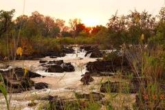 Namibia, Sonnenuntergang an den Popa Falls